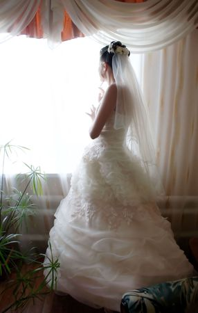 Waiting for the bride for her beloved. The romantic scene filmed in soft shades of bed photo