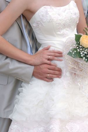Two gold rings linked newlyweds together. Two gold rings, a symbol of love, friendship and mutual understanding photo