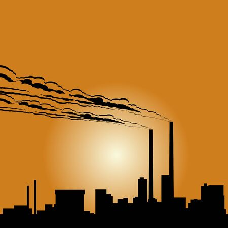 setting sun: Circuit of industrial buildings and smoking chimneys against the setting sun.