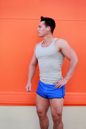 Fitness, sport, workout concept - Sports man posing against\ colorful wall