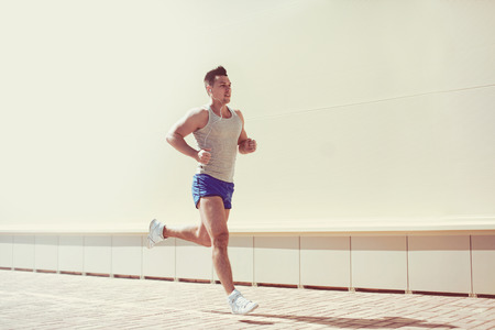 manly man: Fitness, workout, sport, lifestyle concept - man running in the city
