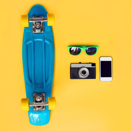 skateboard on a yellow background