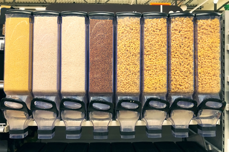 millet, rice, buckwheat, pasta in the containers dispensers Фото со стока - 96480759