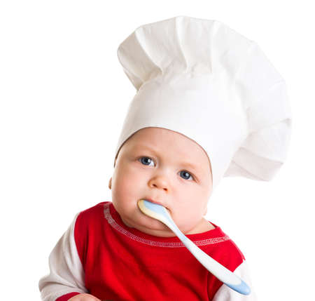 baby with spoon: Baby in the cook costume in the white hat