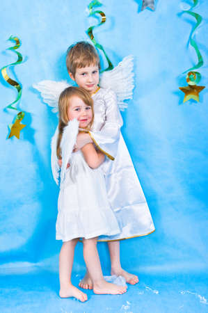 Boy and girl in a costumes with angel wings  Stock Photo - 6735572