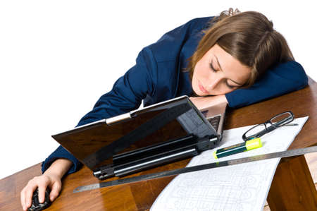 Business woman sleeping on the laptop at her desk  photo