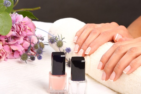 manicure woman: Woman in a nail salon receiving a manicure