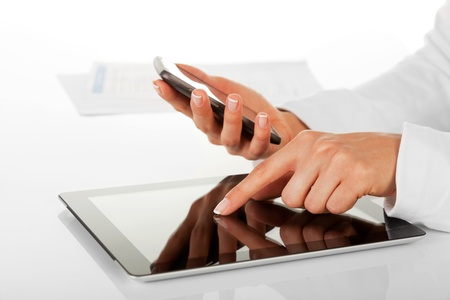 Businesswoman working with digital tablet photo