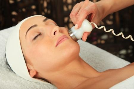 Young woman receiving massage  - microdermabrasion Standard-Bild