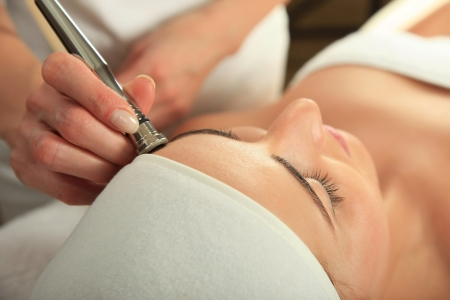 Young woman receiving massage  - microdermabrasion Stock Photo