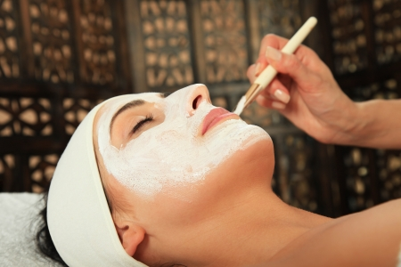 Young woman receiving mask - SPA
