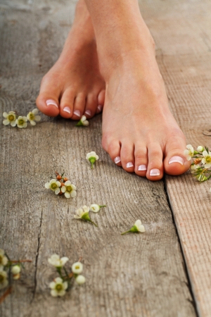 Beauty treatment photo of nice pedicured feet photo