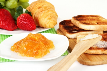Table Breakfast - Continental Breakfast, fruit, jam, and toast. Standard-Bild