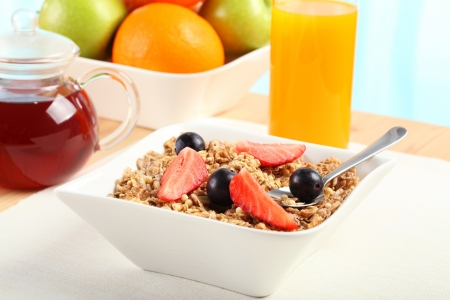 continental breakfast: Table Breakfast - Continental Breakfast, fruit, cereals and orange juice Stock Photo