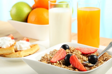 Table Breakfast - Continental Breakfast, fruit, cereals and orange juice Stock Photo