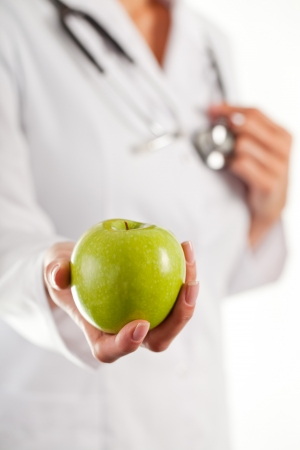 Female doctor with green apple