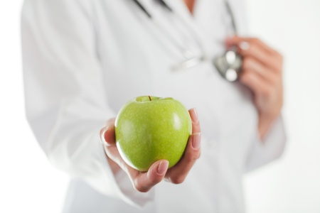 Female doctor with green apple  photo