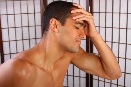 Headache - young man, massage head Standard-Bild