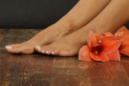 female feet: Beauty treatment photo of nice pedicured feet