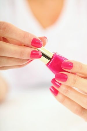 finger nail: Woman in a nail salon receiving a manicure