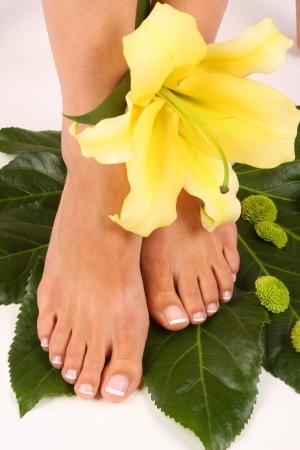 Beauty treatment photo of nice pedicured feet