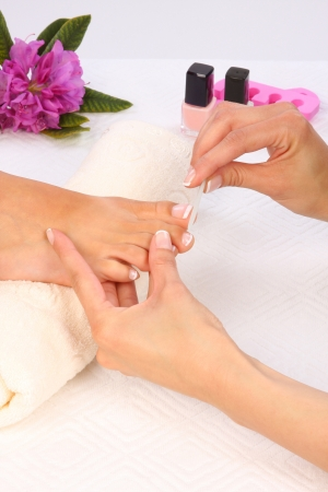 Beauty treatment photo of nice pedicured feet Stock Photo - 18707877