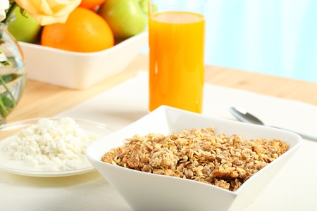 Table Breakfast - Continental Breakfast, fruit, cereals, orange juice  Stock Photo