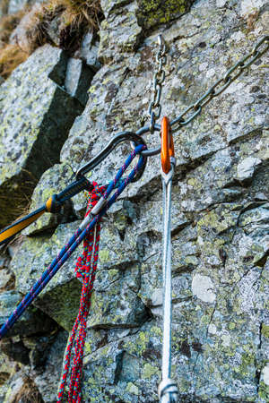 Self-arrest on a belay ledge in the mountains photo