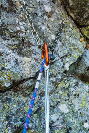 rappel: Self-belay on a belay stance in the mountains Stock Photo