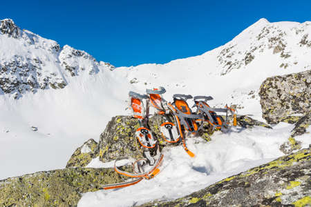crampons: Crampons with winter mountain landscape in the background. Stock Photo