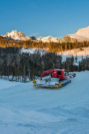 snowcat: Red snowcat in the mountains during operation