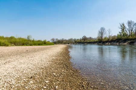 aggregates: River and stone beach on a beautiful sunny day Stock Photo