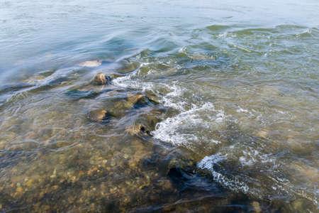rock bottom: Foamed water on the river