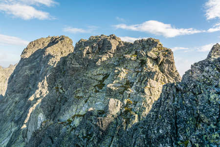 largely: Mountain peaks in the High Tatras are composed largely of granite rock Stock Photo