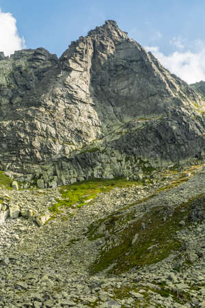 common goal: Vertical wall Wolowa Turnia (Volia veza, Volova veza) in the Tatra Mountains common goal climbers Stock Photo