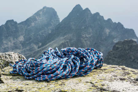 gully: Blue rope with red and white pattern against a mountain ridge