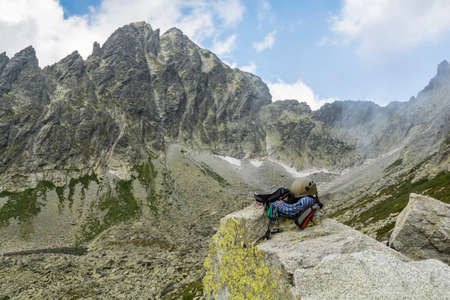 descender: Dynamic rope, helmet, carabiners, climbing harness and descender on the rock in Tatra Valley in Slovakia Stock Photo