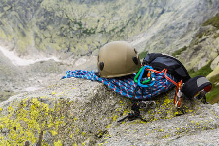 karabiner: Basic climbing equipment (rack, gear, hardware) on a rock in the mountains