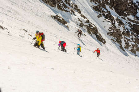 exhaustive: Vysne Hagy, Slovakia - March 29, 2014: Tourists on their way to the top of a very steep couloir. Editorial