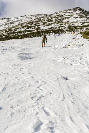 ascent: Tatranska Lomnica, Slovakia - December 26, 2015: Skier during ascent piste skiing in the Tatras.