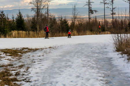 stary: Stary Smokovec, Slovakia - December 28, 2015: Mother and child skiing on piste. Editorial