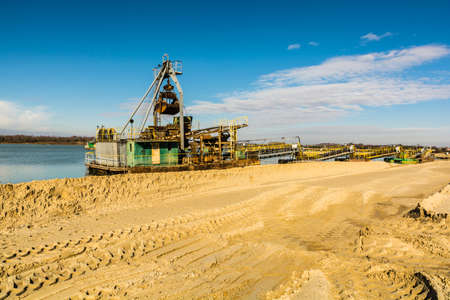 mining ship: Dredge for the extraction of gravel pits aggregate in water. Stock Photo