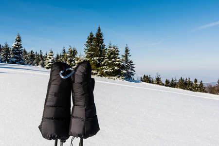 stapled: Gloves clipped carabiner founded on trekking poles.
