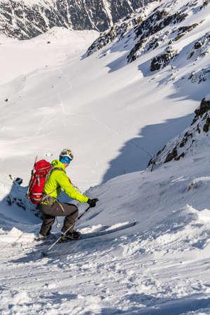 downhill skiing: Zakopane, Poland, - March 28, 2016: Ski mountaineering during downhill skiing in the couloir. Editorial