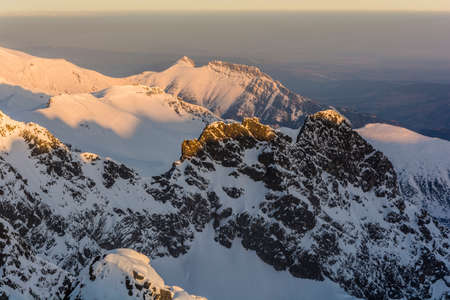 giewont: Most peaks (Giewont, Kasprowy Wierch, Kasprov vrch) in the Tatras Polish in the morning sun. Stock Photo