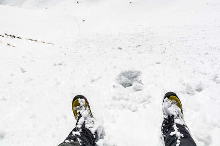 gaiters: Winter boots and gaiters in the snow while skiing down the slope. Stock Photo