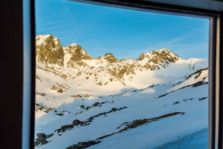mountain hut: Peaks seen through the window mountain hut.