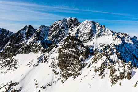 surrounding: Gerlach massif and numerous surrounding peaks in the winter coat. Stock Photo