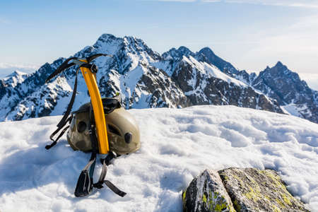 ice axe: Glacier glasses, helmet and ice axe in the mountains. Stock Photo