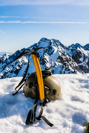 ice axe: Ice axe, helmet and glasses glacial winter in the mountains. Stock Photo